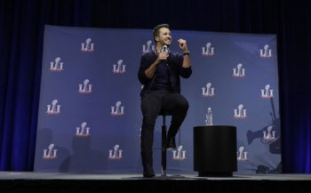 Luke Bryan answers questions at a news conference for the NFL Super Bowl 51 football game Thursday, Feb. 2, 2017, in Houston. (AP Photo/David J. Phillip)