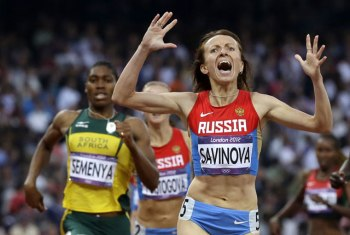 This is a Saturday, Aug. 11, 2012 file photo of Russia's Maria Savinova as she celebrates as she crosses the finish line ahead of South Africa's Caster Semenya to win the women's 800-meters final the athletics in the Olympic Stadium at the 2012 Summer Olympics, London. (AP Photo/Anja Niedringhaus, File)