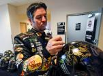 Martin Truex Jr. autographs helmets for race sponsor Monster Energy drink during NASCAR Daytona 500 media day at Daytona International Speedway, Wednesday, Feb. 22, 2017, in Daytona Beach, Fla. (AP Photo/John Raoux)