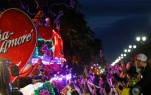 Float riders toss beads during the Krewe of Bacchus Mardi Gras parade in New Orleans, Sunday, Feb. 26, 2017. (AP Photo/Gerald Herbert)