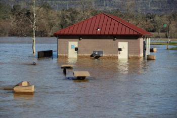 A building is submerged from the overflowing Feather River downstream from a damaged dam at Riverbend Park on Tuesday, Feb. 14, 2017, in Oroville, Calif. Workers are rushing to repair the barrier at the nation's tallest dam after authorities on Sunday ordered the evacuation for everyone living below the lake amid concerns the spillway could fail and send water roaring downstream. (AP Photo/Marcio Jose Sanchez)