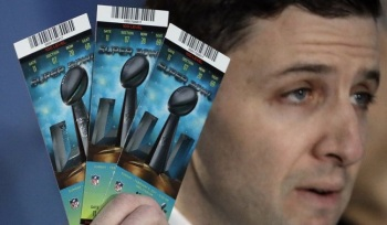 NFL Senior Counsel of Legal Affairs Michael Buchwald holds up Super Bowl 51 tickets as he explains the anti-counterfeit features of legitimate tickets during a news conference for the NFL Super Bowl 51 football game Thursday, Feb. 2, 2017, in Houston. (AP Photo/David J. Phillip)