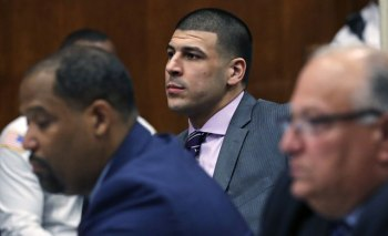 In this Wednesday, Dec. 7, 2016, file photo, former New England Patriots NFL football player Aaron Hernandez, center, sits with his defense team during a court appearance at Suffolk Superior Court in Boston. (AP Photo/Charles Krupa, File)