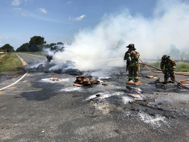 Photos: Truck dumps flaming load of cardboard onto Duplin County road