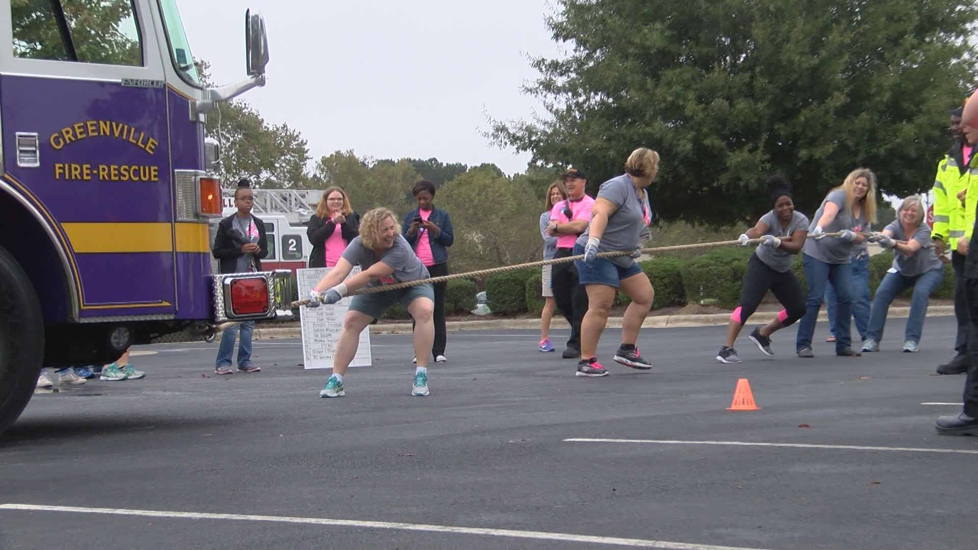 Teams Pull Concrete Mixer for Breast Cancer Research