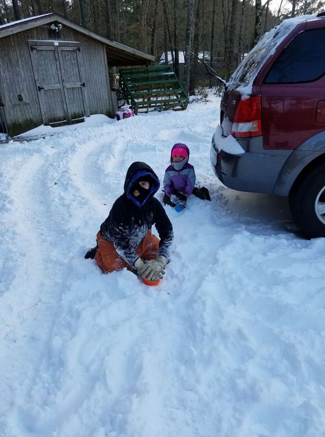 Kids working on a snow castle