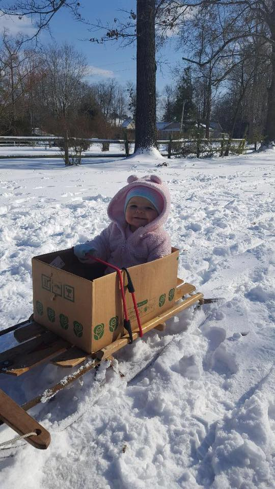 With roads blanketed by snow, eastern Carolina fights to dig out