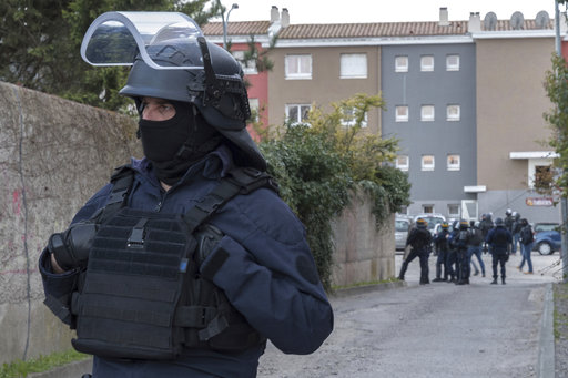 Gunman in France kills three, then takes hostages in supermarket